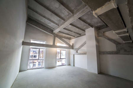 Empty spacious loft under construction photo