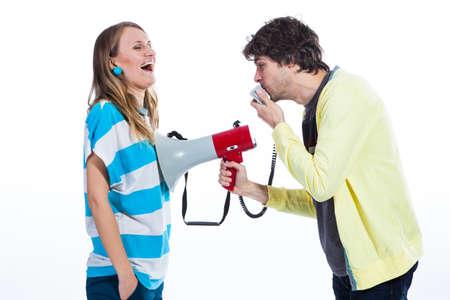 Couple using megaphone to speak Stock Photo