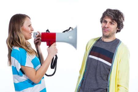 Woman using megaphone to talk to a husband