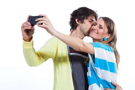 Young couple taking their selfportrait