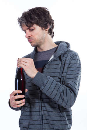 Man inspecting red wine bottle