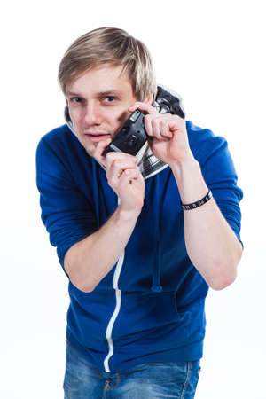 Young man photographing in the studio