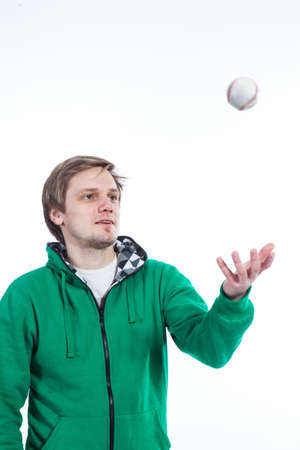 Man throwing baseball in the air