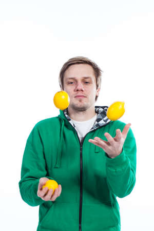 Man juggling with fruit Stock Photo