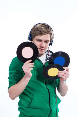 Young man holding vinyls