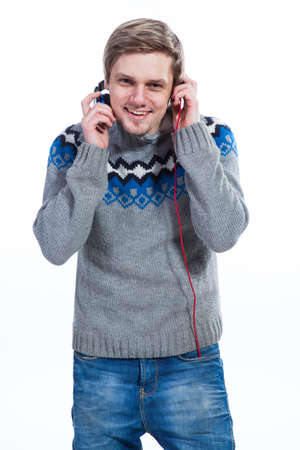 Young man with headphones in sweater
