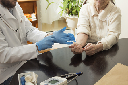doctor s smock: Doctor in the doctors office with patient. It is assumed disposable gloves before the test.