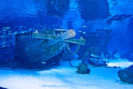 sunken: Dark blue water with sunken ship wreckage