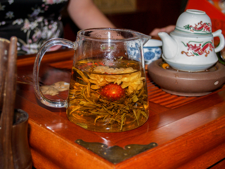 Chinese flower tea at transparent glass teapot