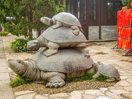 three generations: Three turtles statue at Hainan Park of longevity as symbol of family generations