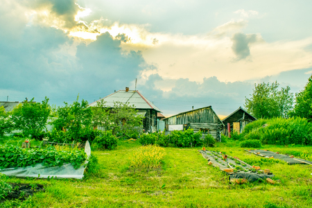 urals: Russian house with garden at old traditional village, The Urals Stock Photo
