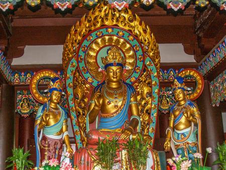 Buddha colorful statues at Hainan park Nanshan Stock Photo