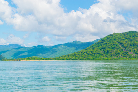 calmness: Sea shore at a paradise island with cloudy sky -the South China sea - Vietnam Nha Trang bay Stock Photo
