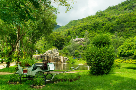 Landscape design aa tropcal park with carriage, trees and mountains, Vietnam, Orchid Island