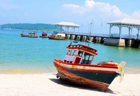 fishing boat parking when low tide photo