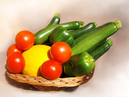 Vegetables  in basket, tomatoes, melon, zucchini. Stock Photo