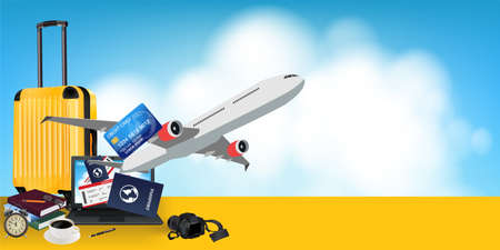 Yellow suitcase with laptop computer, camera, tickets, passport, credit card, travel