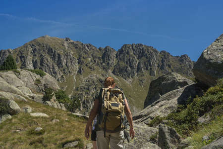 Female athlete walking through all of the Pyrenees in summer