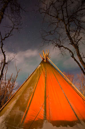 Tent with bonfire at night