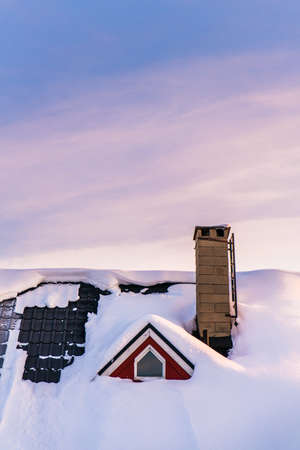 View to roof of the house covered with snow in sunny day LANG_EVOIMAGES