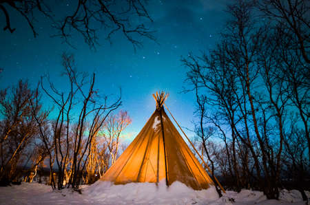 Tent in winter forest LANG_EVOIMAGES