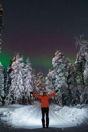 Man standing on winter road