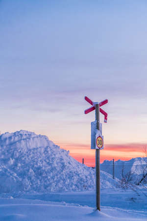 Railroad post in winter LANG_EVOIMAGES