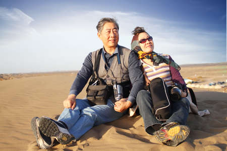 asian old woman: In Oct. 2010, my whole family drove to the largest desert in China. Explore the desert and enjoy the fun.
