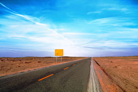 An image of desert traffic desert road in China, with a banner aside for abstract concept Stock Photo - 11225510
