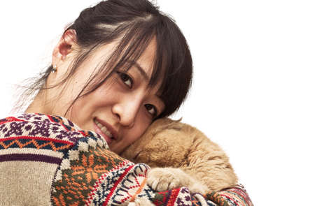 cpa: Isolation photo of a pretty Chinese girl hugging her pet, a CPA garfield cat Stock Photo