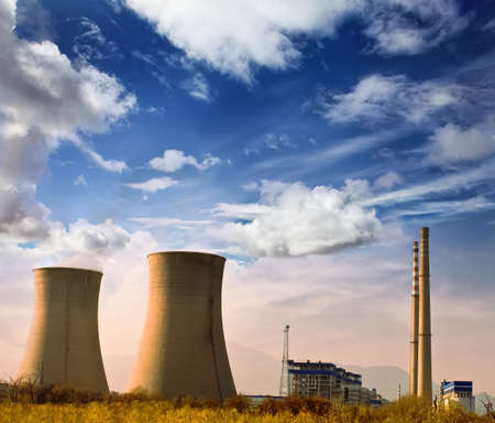 nuclear energy: Landscape photo of industrial factory with power chimneys in blue sky in rurial area