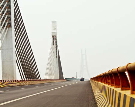 Photo of Traffic in Yellow River bridge of a heavy foggy day. photo