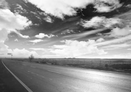 An image of desert traffic desert road in China, with a banner aside for abstract concept