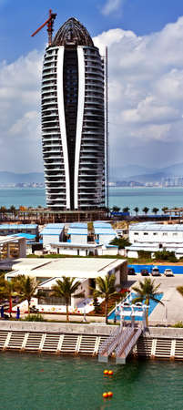 Modern tall building under construction in Phoenix Island Bay of Sanya city in China