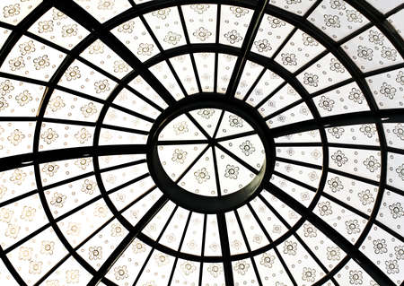 Closeup detail photo of grand round symmetric roof ceiling architecture with flowers as decorations Stock Photo