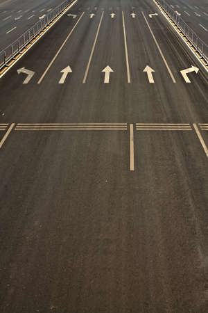 Details of wide street roads with traffic symbols photo