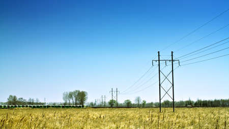 High voltage electrical power line in the field with abandoned shuttle buses Stock Photo - 13207100