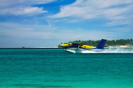 Landscape photo of Sea plane flying above ocean photo