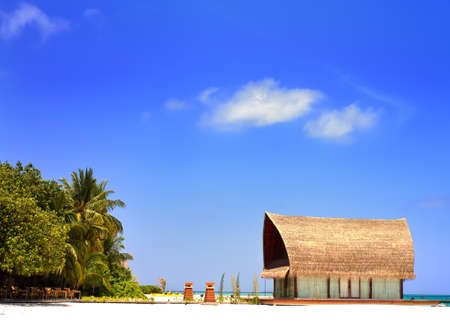Landscape photo of Beachfront villa with clear blue sky in Maldive