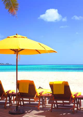 Landscape photo of Coast beach sleeping chair in Maldive beach front villa Stock Photo