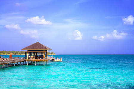 Landscape photo of Island in ocean, overwater villa with endless swimming pools. Maldives.  photo