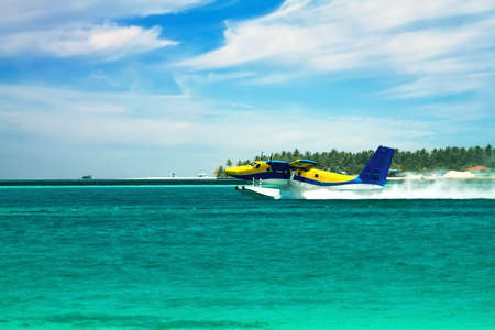 Landscape photo of Sea plane flying above ocean