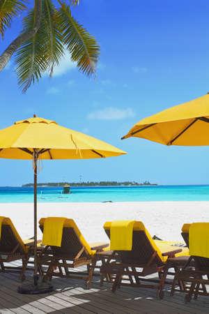 beach front: Landscape photo of Coast beach sleeping chair in Maldive beach front villa Stock Photo