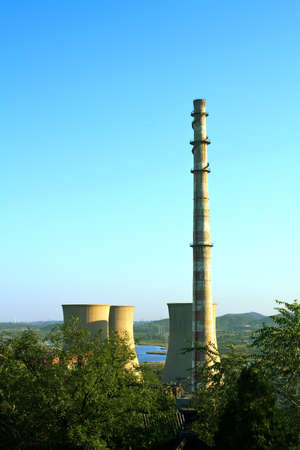 Landscape of construction power factories with big chimneys and modern buildings in background photo