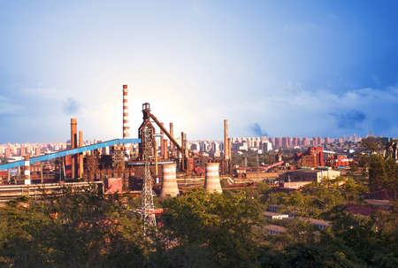 Landscape of construction power factories with big chimneys and modern buildings in background Stock Photo
