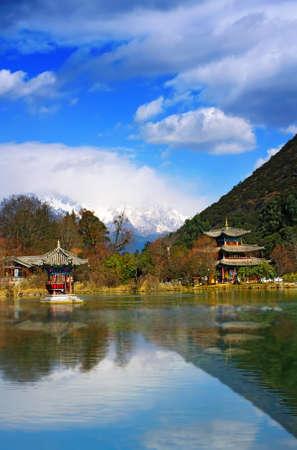 Landscape photo of Beautiful Pavilion In Black Dragon Pool Park, Lijiang Yunnan Province, China Stock Photo