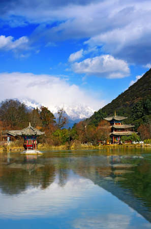 Landscape photo of Beautiful Pavilion In Black Dragon Pool Park, Lijiang Yunnan Province, China Stock Photo