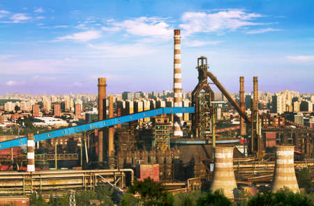Landscape of construction power factories with big chimneys and modern buildings in background