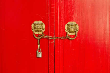 Closeup photo of traditional Chinese locks with red doors