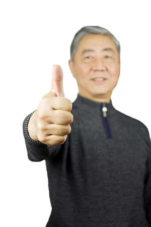 Closeup isolation photo of senior Chinese man showing ok and good with fingers Stock Photo - 17279872